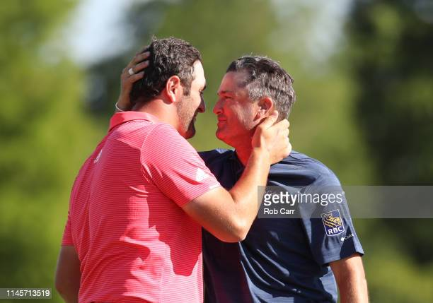 Jon Rahm of Spain and Ryan Palmer of the United States react after putting in to win on the 18th green during the final round of the Zurich Classic...