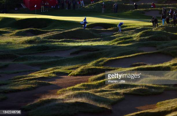 Jon Rahm of Spain and team Europe plays a shot from a bunker on the first hole during Friday Morning Foursome Matches of the 43rd Ryder Cup at...