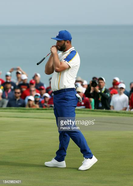 Jon Rahm of Spain and team Europe reacts on the 15th green against Scottie Scheffler of team United States during Sunday Singles Matches of the 43rd...