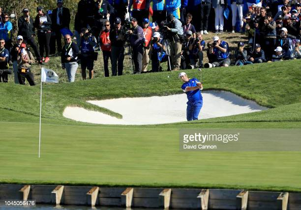 Jon Rahm of Spain and the European Team plays his second shot on the second hole in his match against Tiger Woods of the United States team during...