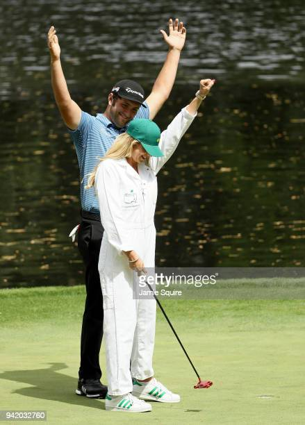 Jon Rahm of Spain and wife Kelley Cahill react during the Par 3 Contest prior to the start of the 2018 Masters Tournament at Augusta National Golf...