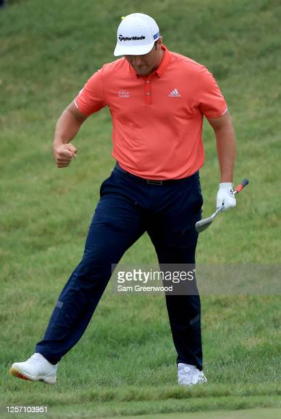 Jon Rahm of Spain celebrates after chipping in for birdie on the 16th hole during the final round of The Memorial Tournament on July 19, 2020 at...