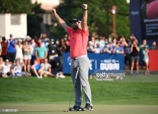 Jon Rahm of Spain celebrates after putting in for a birdie on the eighteenth green to win the DP World Tour and Race to Dubai during Day Four of the...