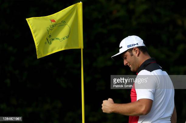 Jon Rahm of Spain celebrates his hole in one on the fourth hole during a practice round prior to the Masters at Augusta National Golf Club on...