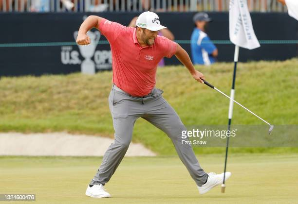 Jon Rahm of Spain celebrates making a putt for birdie on the 18th green during the final round of the 2021 U.S. Open at Torrey Pines Golf Course on...