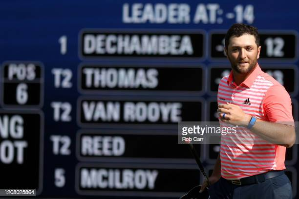 Jon Rahm of Spain celebrates on the 18th green after breaking the course record during the third round of the World Golf Championships Mexico...