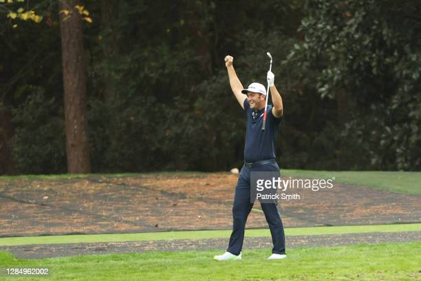 Jon Rahm of Spain celebrates skipping in for a hole in one on the 16th during a practice round prior to the Masters at Augusta National Golf Club on...