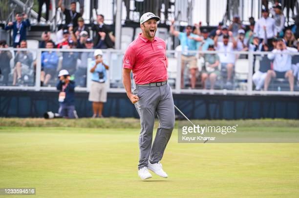 Jon Rahm of Spain celebrates with a fist pump after making a birdie putt on the 18th hole green during the final round of the 121st U.S. Open on the...