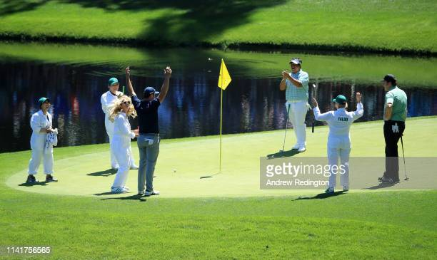 Jon Rahm of Spain celebrates with girlfriend Kelley Cahill after a putt during the Par 3 Contest prior to the Masters at Augusta National Golf Club...