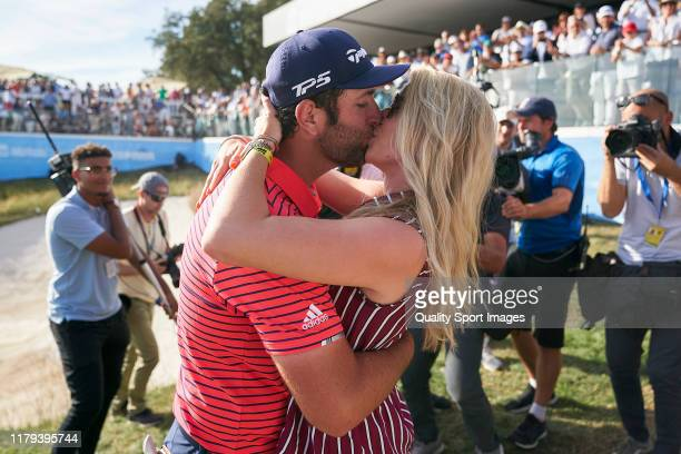 Jon Rahm of Spain celebrates with girlfriend Kelley Cahill at the end of the Day 4 of the Open de Espana at Club de Campo Villa de Madrid on October...