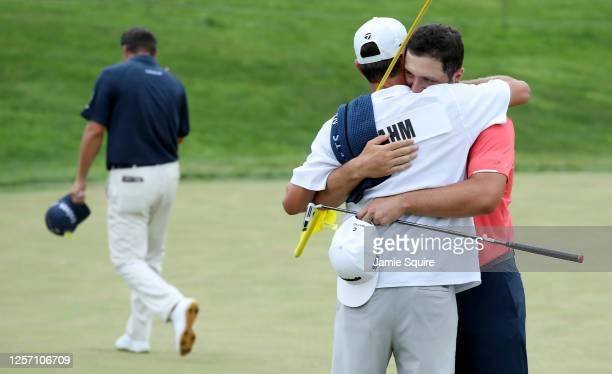 Jon Rahm of Spain celebrates with his caddie Adam Hayes after winning on the 18th green during the final round of The Memorial Tournament on July 19,...