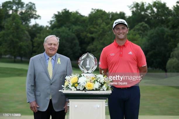 Jon Rahm of Spain celebrates with Jack Nicklaus and the trophy after winning in the final round of The Memorial Tournament on July 19, 2020 at...