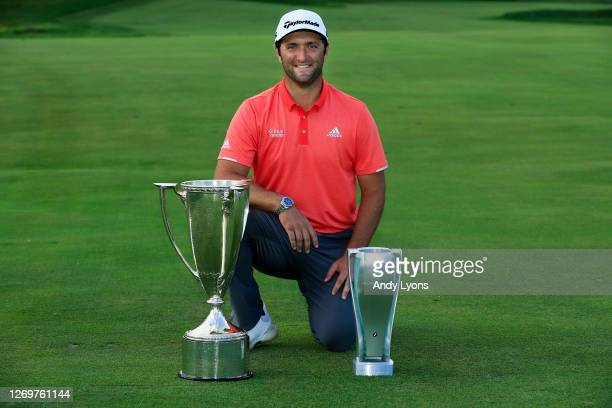 Jon Rahm of Spain celebrates with the J.D. Wadley trophy and the BMW trophy after winning on the first sudden-death-playoff hole against Dustin...