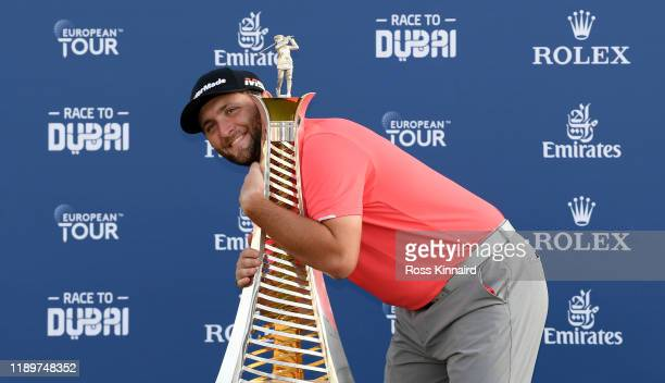 Jon Rahm of Spain celebrates with the Race to Dubai trophy after the final round of the DP World Tour Championship Dubai at Jumeirah Golf Estates on...