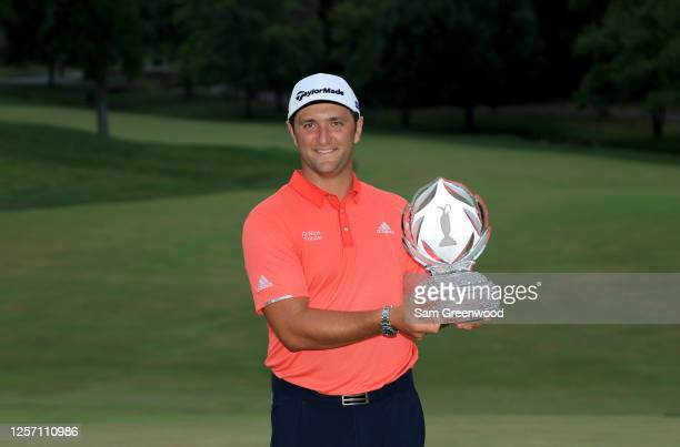 Jon Rahm of Spain celebrates with the trophy after winning during the final round of The Memorial Tournament on July 19 2020 at Muirfield Village...