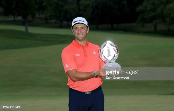 Jon Rahm of Spain celebrates with the trophy after winning during the final round of The Memorial Tournament on July 19, 2020 at Muirfield Village...