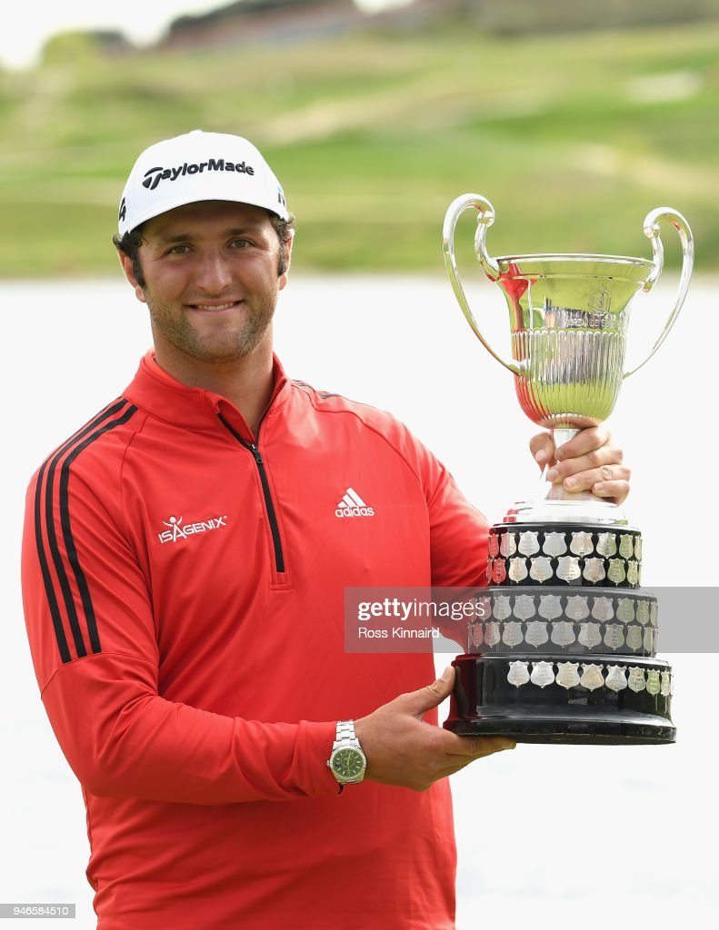 Jon Rahm of Spain celebrates with winners trophy after the final round of the Open de Espana at Centro Nacional de Golf on April 15, 2018 in Madrid, Spain.