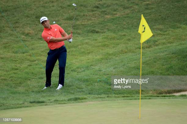 Jon Rahm of Spain chips in for birdie on the 16th hole during the final round of The Memorial Tournament on July 19, 2020 at Muirfield Village Golf...