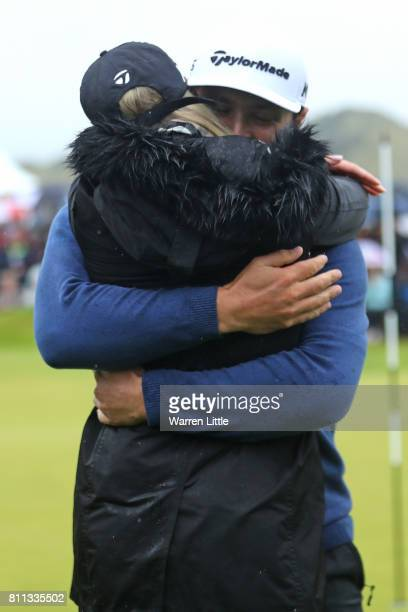 Jon Rahm of Spain embraces girlfriend Kelley Cahill after his victory on the 18th hole during the final round of the Dubai Duty Free Irish Open at...