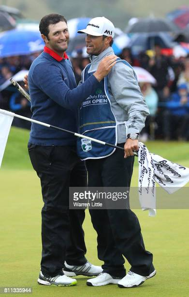 Jon Rahm of Spain embraces his caddie Adam Hayes after his victory on the 18th green during the final round of the Dubai Duty Free Irish Open at...