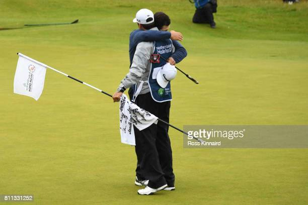Jon Rahm of Spain embraces his caddie after his victory on the 18th green during the final round of the Dubai Duty Free Irish Open at Portstewart...