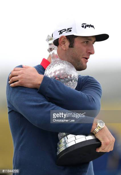 Jon Rahm of Spain embraces the trophy after his victory during the final round of the Dubai Duty Free Irish Open at Portstewart Golf Club on July 9...
