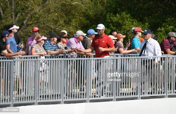 Jon Rahm of Spain greets fans along the 11th hole during the championship match at the World Golf Championships Dell Technologies Match Play at...