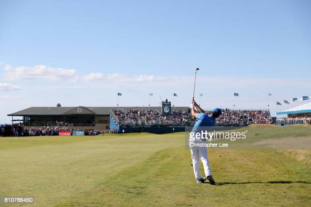 Jon Rahm of Spain hits an approach to the 18th green during day three of the Dubai Duty Free Irish Open at Portstewart Golf Club on July 8 2017 in...