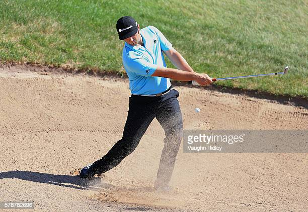 Jon Rahm of Spain hits from a green side sand trap to 14th green during the second round of the RBC Canadian Open at Glen Abbey Golf Club on July 22,...