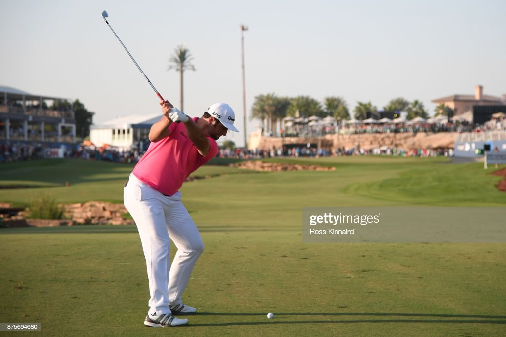 Jon Rahm of Spain hits his second shot on the 18th hole during the third round of the DP World Tour Championship at Jumeirah Golf Estates on November 18, 2017 in Dubai, United Arab Emirates.