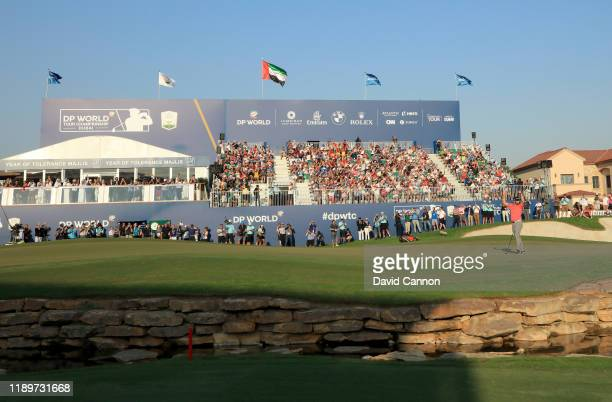 Jon Rahm of Spain holes the winning putt on the 18th green during the final round of the DP World Tour Championship Dubai on the Earth Course at the...