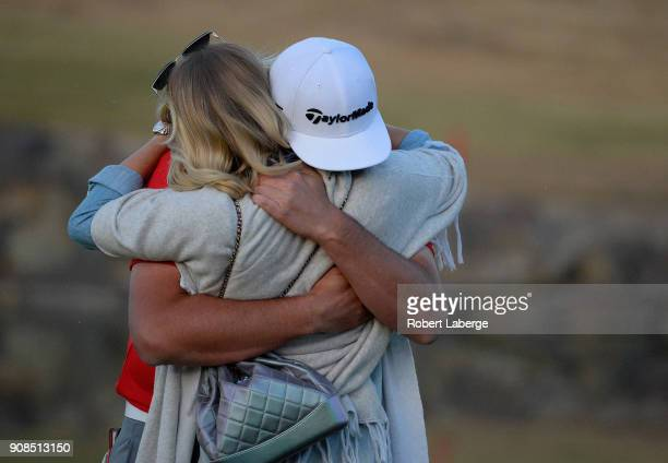 Jon Rahm of Spain hugs his girlfriend Kelley Cahill after putting in to win on the fourth hole of a sudden death playoff during the final round of...