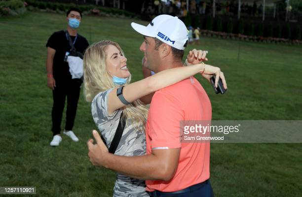 Jon Rahm of Spain is celebrates with his wife Kelley Cahill after winning during the final round of The Memorial Tournament on July 19 2020 at...