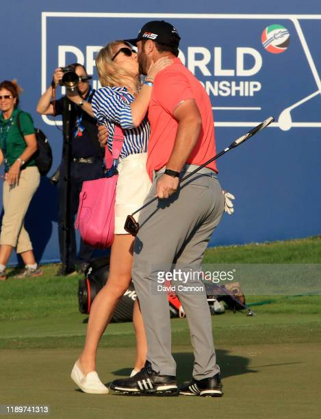 Jon Rahm of Spain is embraced by his fiancee Kelley Cahill after he had holed the winning putt on the 18th green during the final round of the DP...