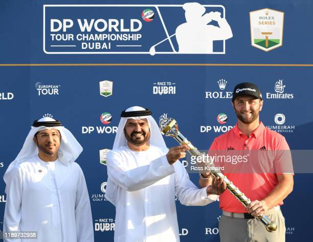 Jon Rahm of Spain is presented with the DP World Tour Championship trophy by Mohammed Al Muallem, Senior Vice President & Managing Director, UAE...