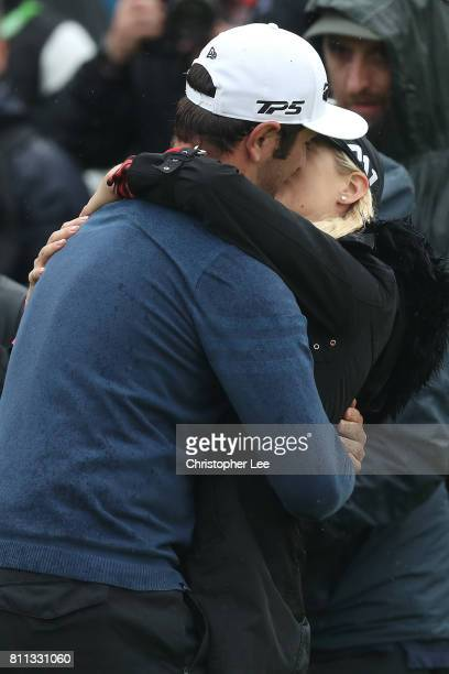 Jon Rahm of Spain kisses girlfriend Kelley Cahill after his victory on the 18th hole during the final round of the Dubai Duty Free Irish Open at...