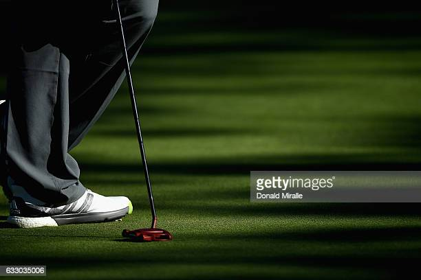 Jon Rahm of Spain lines up a putt on the 18th tee during the final round of the Farmers Insurance Open at Torrey Pines South on January 29 2017 in...