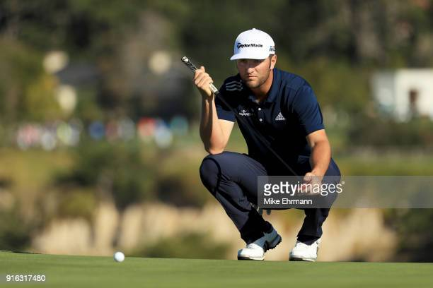 Jon Rahm of Spain lines up a putt on the sixth green during Round Two of the ATT Pebble Beach ProAm at Pebble Beach Golf Links on February 9 2018 in...