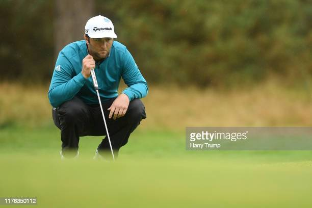 Jon Rahm of Spain lines up his shot before he putts on the 9th green during Day 4 of the BMW PGA Championship at Wentworth Golf Club on September 22...