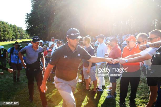 Jon Rahm of Spain makes his way from the 13th hole to the 14th hole during Day Three of the BMW PGA Championship at Wentworth Golf Club on September...