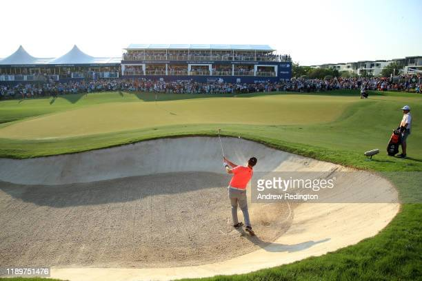 Jon Rahm of Spain plays a bunker shot for his third shot on the eighteenth during Day Four of the DP World Tour Championship Dubai at Jumerirah Golf...