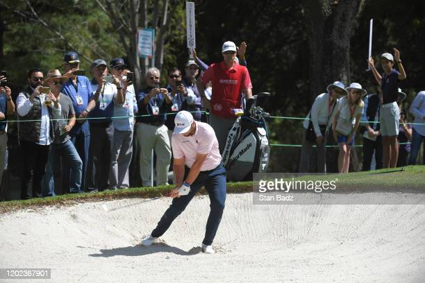 Jon Rahm of Spain plays a bunker shot on the tenth hole during the second round of the World Golf Championships-Mexico Championship at Club de Golf...