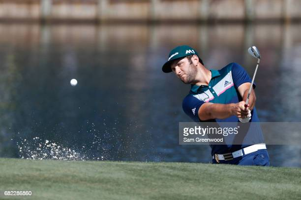 Jon Rahm of Spain plays a shot from a bunker on the 16th hole during the second round of THE PLAYERS Championship at the Stadium course at TPC...