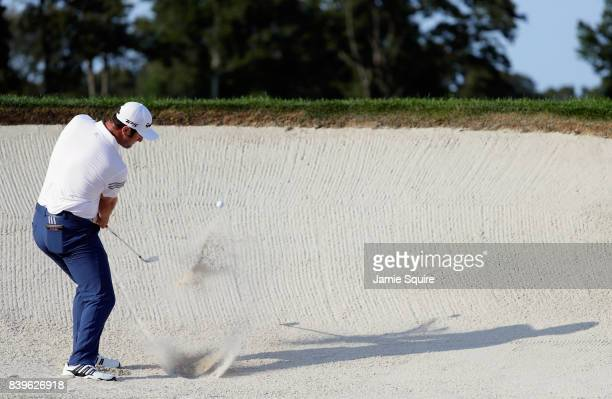 Jon Rahm of Spain plays a shot from a bunker on the 18th hole during round three of The Northern Trust at Glen Oaks Club on August 26 2017 in...