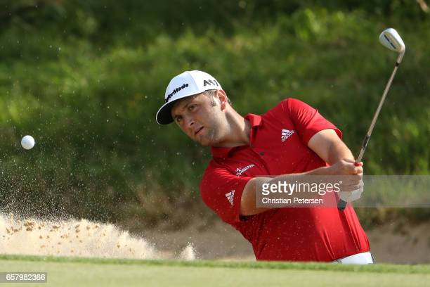 Jon Rahm of Spain plays a shot from a bunker on the 7th hole of his match during the semifinals of the World Golf ChampionshipsDell Technologies...