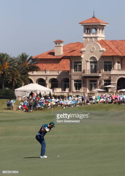 Jon Rahm of Spain plays a shot on the 18th hole during the second round of THE PLAYERS Championship at the Stadium course at TPC Sawgrass on May 12...