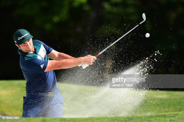Jon Rahm of Spain plays a shot out of a bunker on the 11th hole during round one of the Wells Fargo Championship at Eagle Point Golf Club on May 4...