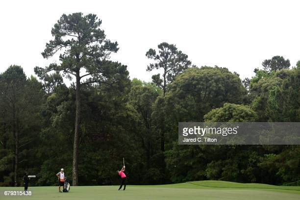 Jon Rahm of Spain plays an approach shot on the 12th hole during round two of the Wells Fargo Championship at Eagle Point Golf Club on May 5 2017 in...