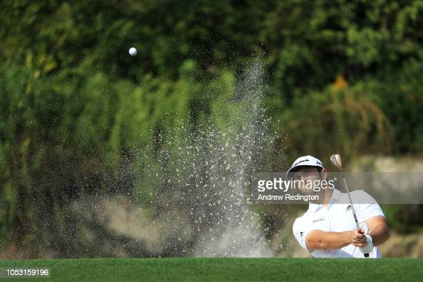 Jon Rahm of Spain plays his fourth shot on the 14th hole during the first round of the WGC HSBC Champions at Sheshan International Golf Club on...