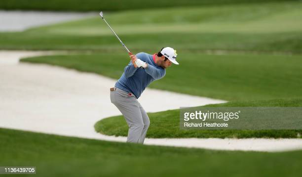 Jon Rahm of Spain plays his second shot on the 11th hole during the final round of The PLAYERS Championship on The Stadium Course at TPC Sawgrass on...